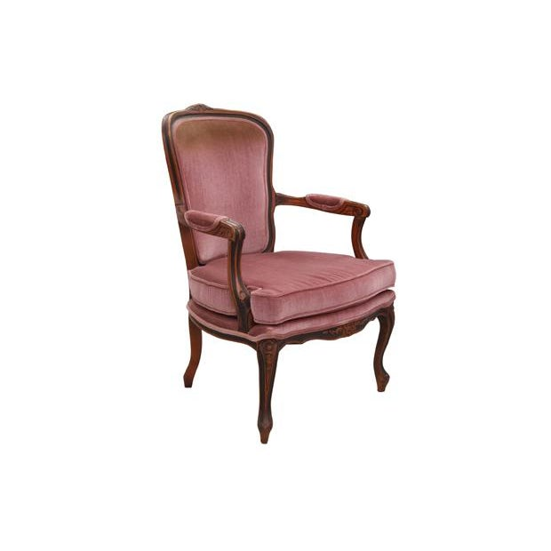 A pair of Louis XV style armchairs upholstered in a vintage velvet in dusty rose. The frame is made of mahogany and is...