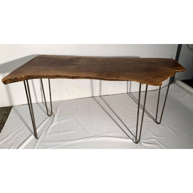 """A very lovely California Claro walnut slab, 2"""" thick, fitted as a Console table or desk with thin metal legs. The top has..."""