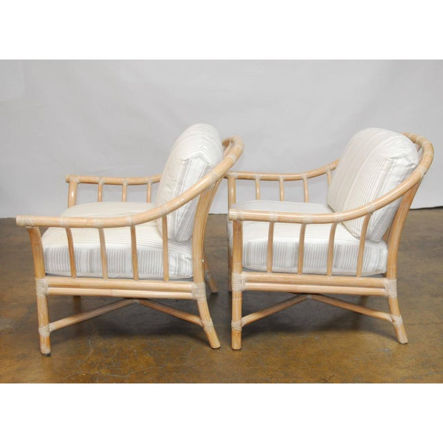 Fabulous set of 4 bamboo armchairs with barrel back horseshoe shape. The chairs are a chic cerused finish and wrapped with...