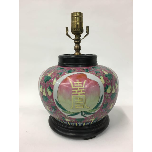 Chinese Vintage pink jar lamp with big long life character on top of bun which shape look like peach. There are lots...