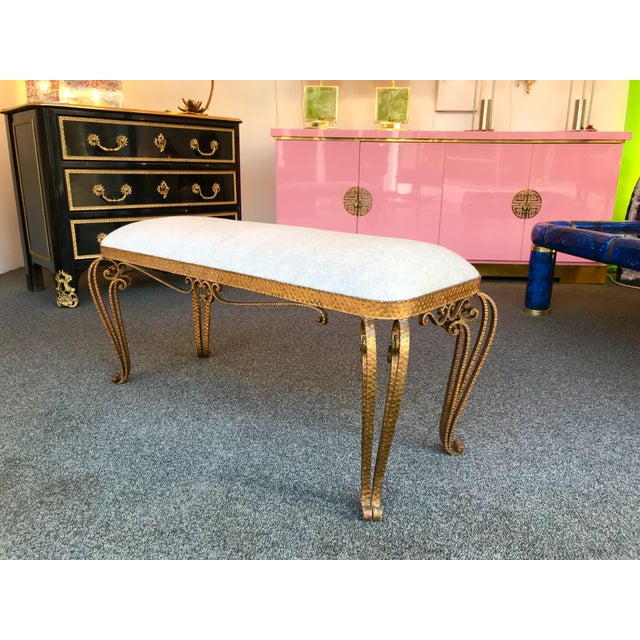 Very fine model of bench by Pier Luigi Colli. Hammered wrought iron and gold leaf . Fully upholstered with a lamb wool and...