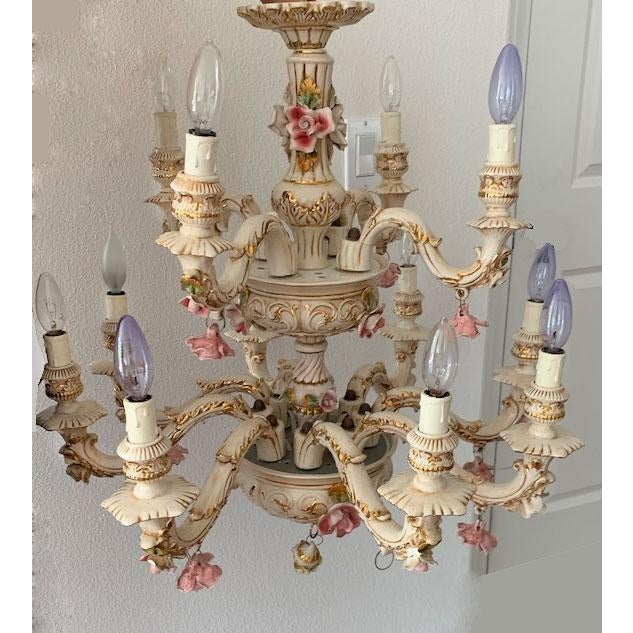 Beautiful Capodimonte Italian porcelain 12-arm chandelier is hand-painted with pink roses and gold accents. Each arm is...