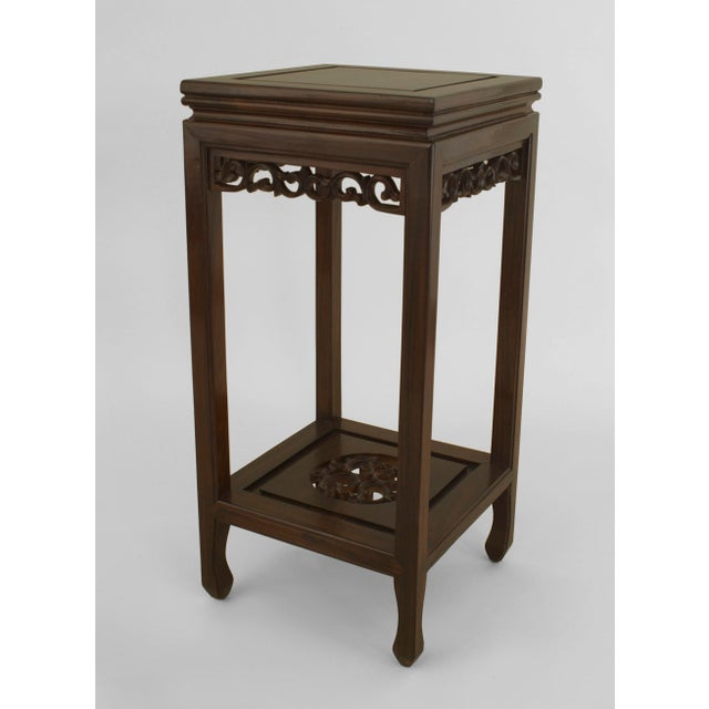 Pair of Asian Chinese (19/20th Cent) rosewood pedestals with square tops and a carved apron having a filigree carved...