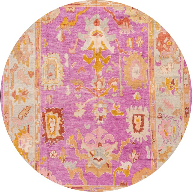 Beautiful Contemporary Turkish Oushak rug, hand-knotted wool with a pink field, and multicolor accents in all-over...