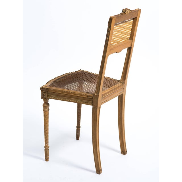 1920s hand-carved French caned side chair. Perfect for a traditional style home.