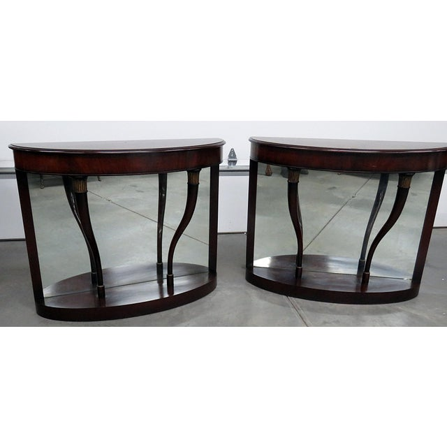 Pair of regency style pier tables with mirrored backs. Made in the late 20th century.