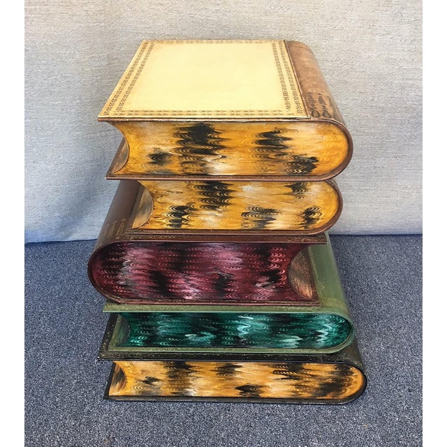 Fantastic Italian Tole stacked books painted metal side table. This small table opens for extra storage with maximum...