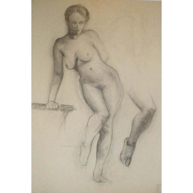 Large charcoal drawing of a life model in studio, female nude with study of lower leg to the side. On large format fine...