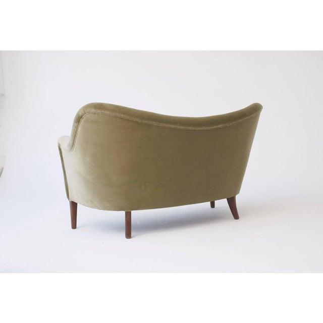 Elegant curved 1950s sofa or loveseat, model 185, Slagelse Mobler, Denmark, 1950s. Re-upholstery options available. Ships...