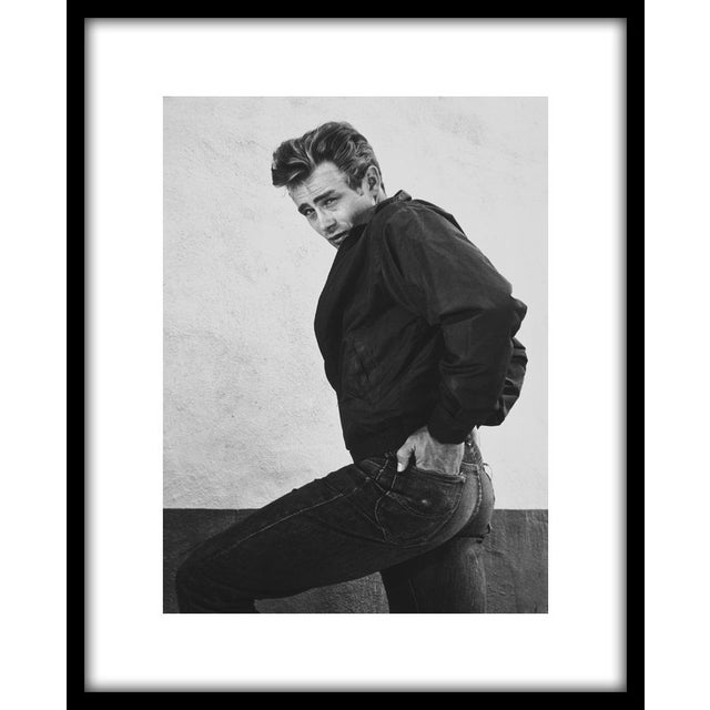 """James Dean on the backlot of Warner Brothers, 1955. Photo by Floyd McCarty. 11"""" x 14"""" silver gelatin print. Printed under..."""