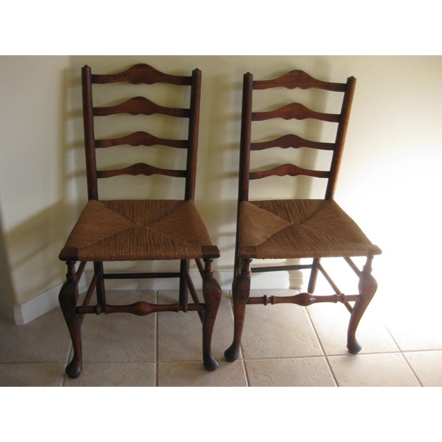 This listing consist of an antique pair of accent chairs in the english ladderback style. They are in good shape with no...