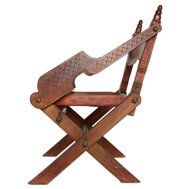 A one-of-a-kind piece from 1930s Mexico, this rustic chair - Antique Mexican Leather & Carved Wood Chair Chairish