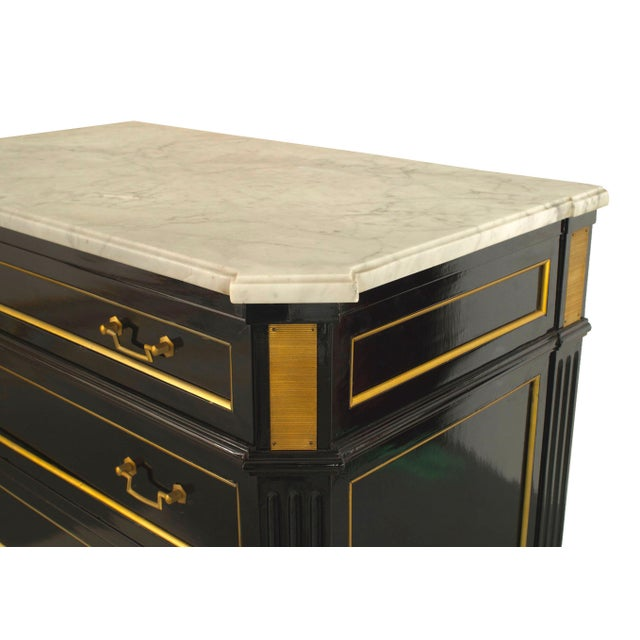 French 1940s (Louis XVI style) ebonized high chest having six bronze trimmed drawers with handles and a white marble top...