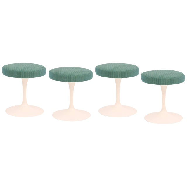 Four Eero Saarinen for Knoll swivel stools, circa early 1960s. These examples have their original finish to the iron tulip...