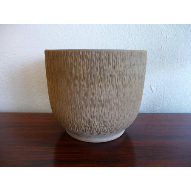 This beautiful mid century modern planter is from Gainey. It has a highly textured sgraffito-like treatment on the outside...