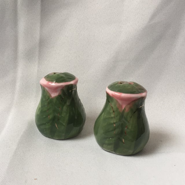 Hand painted rose bud salt and paper shakers. Vintage aging, some wear on the gold leaf details. Each is 2x2x2.5