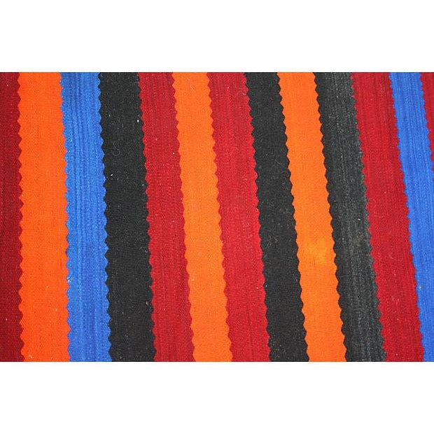 Vintage Moroccan Berber flatweave rug in a lively assortment of colorful stripes.