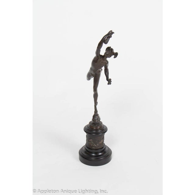Statue of Mercury. Cast in bronze. Beautiful casting with Mercury in a dynamic pose, holding a vial. He is leaping off of...
