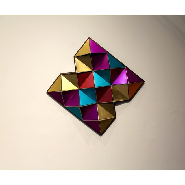 Beautiful, bright geometric wall art made with colored, anodized aluminum panels between thicker, cut aluminum walls....