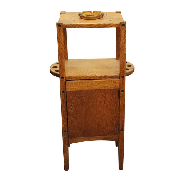 Small freestanding side smoking table with a combination cabinet and key. It is made of natural oak wood with an original...