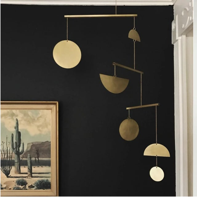 The mobiles are handmade in Austin Texas by designer Corie Humble. They are made from solid brass, a natural material that...