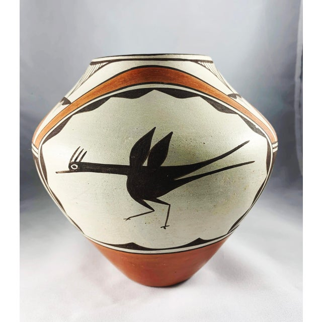 Fabulous and fun Roadrunner polychrome jar signed Eusebia Shije, (from the Zia Pueblo in New Mexico, ca. 1972). The piece...
