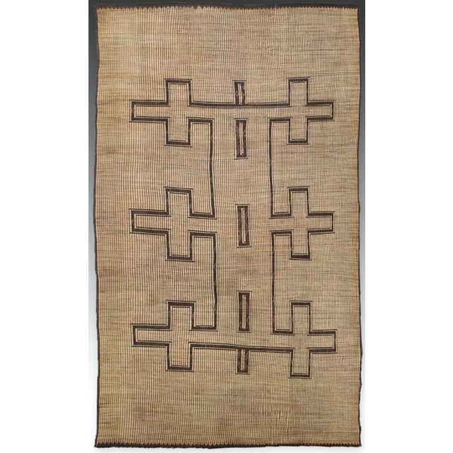 Oversize Tuareg Rug from Northern Africa. Made of Woven reeds and leather. Leather binding is loose in a few spots,...