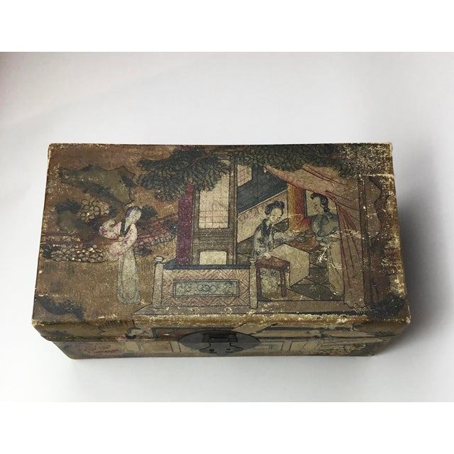 Travel to a bygone era with this charming hand painted hide box. In soft pleasing colors, elegant figures decorate the top...
