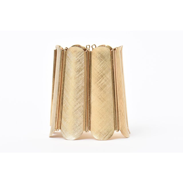 This dramatic signed vintage Napier modern cuff bracelet has a tooled gold tone brush finish on it. It is a wide cuff and...