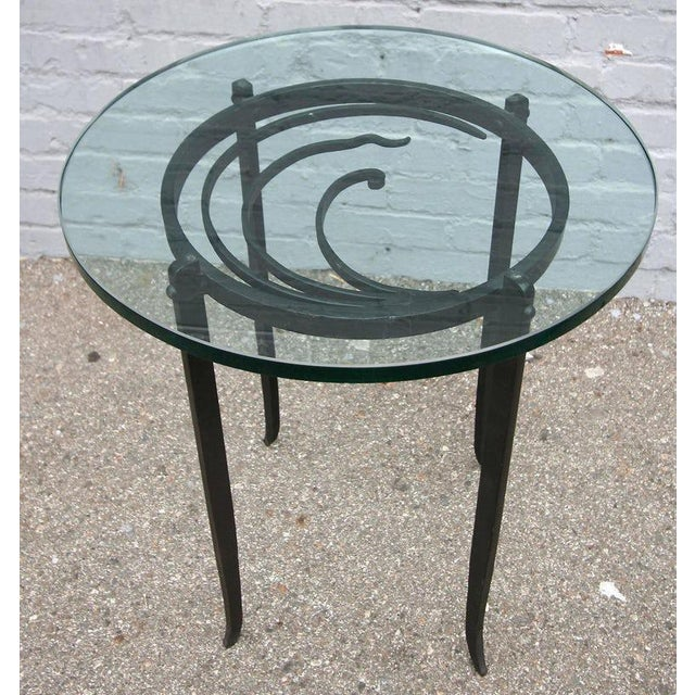 Pair of Art Deco side tables with beautifully detailed iron base and glass top. T-338