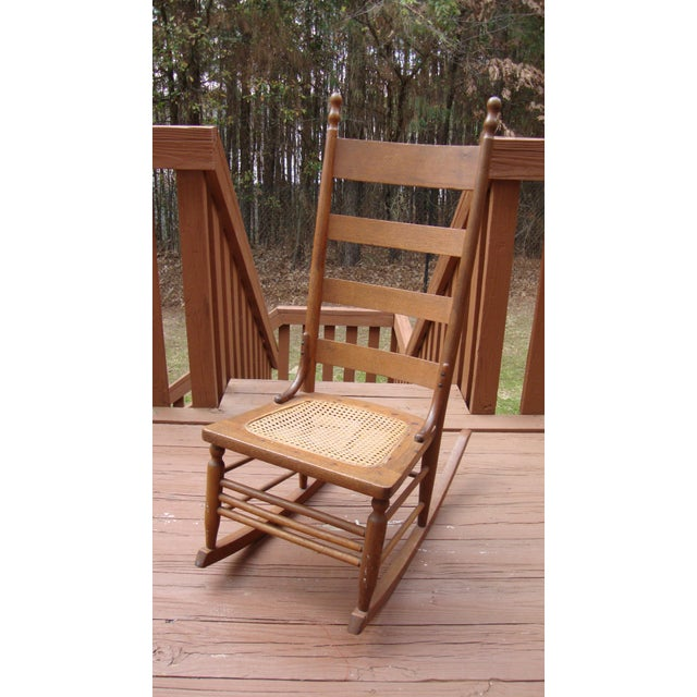 Own a piece of history with this important antique 18th Century Early American Ladderback Rocker. This chair is...