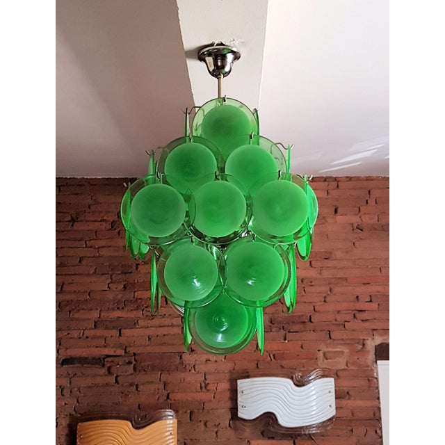 Green Murano glass and chrome frame disc chandelier, by Vistosi. Italy, 1970s. Pyramidal shape. Each hand blown green disc...