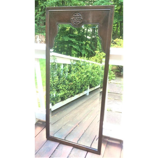 Perfect pair of Hollywood Regency Chinese Chippendale mirrors in carved wood. Tall, slender proportions and beveled glass....