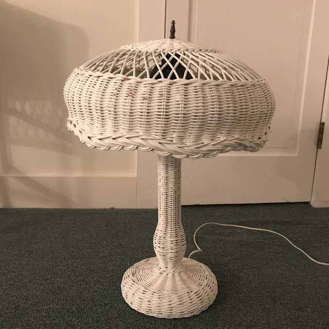 Pretty vintage white wicker table lamp. Dual light bulbs. Solid wicker base. Oversized shade. Perfect for a sun room or...