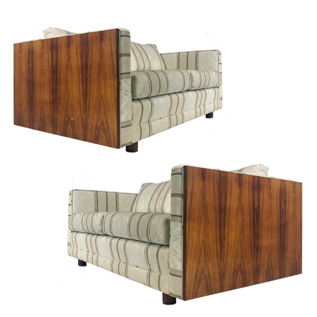 Interesting pair of Mid-Century Modern sofas or settees with Rosewood paneled sides and cylindric legs attributed to Milo...