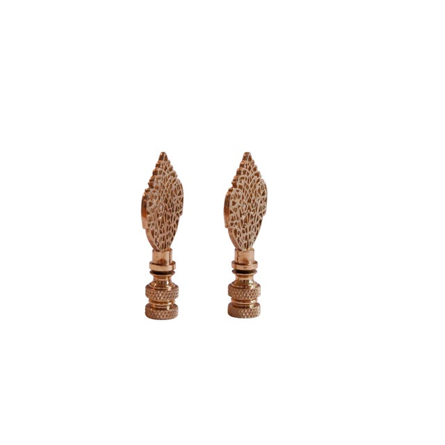 A pair of brass filigree lamp finials. Fits a standard size lamp harp. Dimensions per finial. We have more lamp finials...