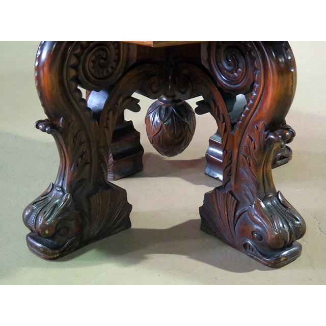 Renaissance style carved dolphin center table with false drawers.