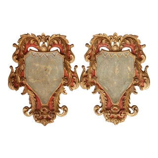 Pair of Early 20th Century Italian Carved Gilt and Painted Wall Hanging Shields For Sale