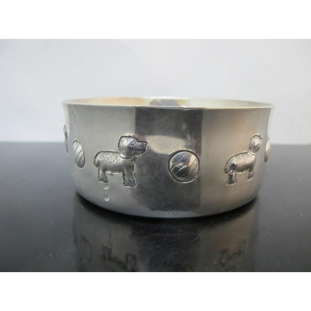 Tiffany sterling silver baby porringer with dog and ball design around body. Marked Tiffany & Co Makers 25899 Sterling 925...