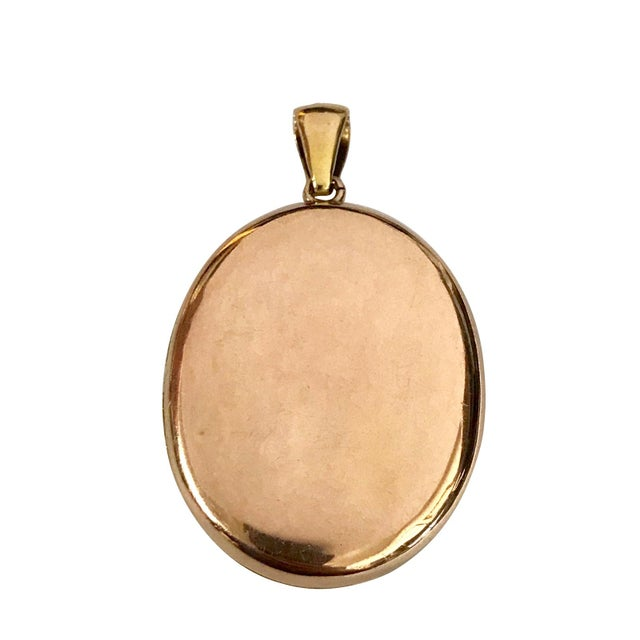 A fine Victorian 18K gold picture locket with turquoise. The top of the locket, inside front and back test 18K. The...