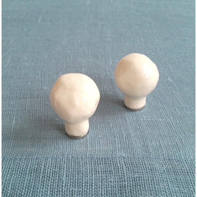 Two white ceramic lamp finials. These hand formed organic shaped lamp finials are my small size. (there is a larger size...