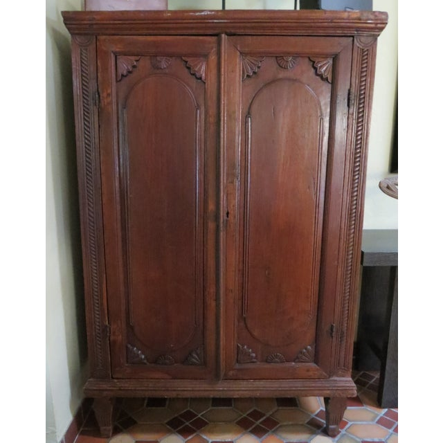 18th century, Dutch Colonial style armoire from Indonesia. A lot of hand crafted details, very unique piece. 3 large...
