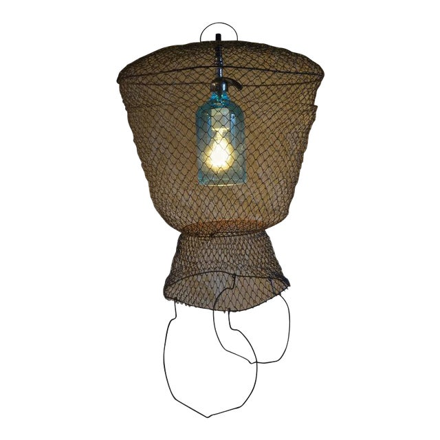 Pendant Light from Seltzer Bottle Suspended in French, Steel Mesh Fish Basket - Image 1 of 11