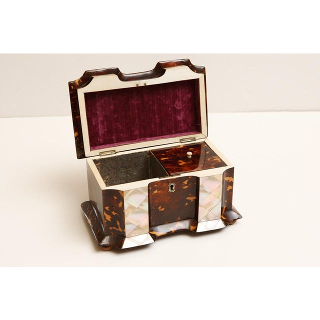 Mid 19th century tortoise shell tea caddy. Mother of Pearl and ivory accents. Original lids on tea conpartments.