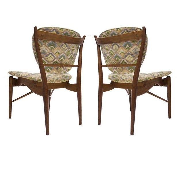 A nice pair of Finn Juhl for Baker Furniture walnut framed chairs. The chairs where reupholstered in a tapestry style...