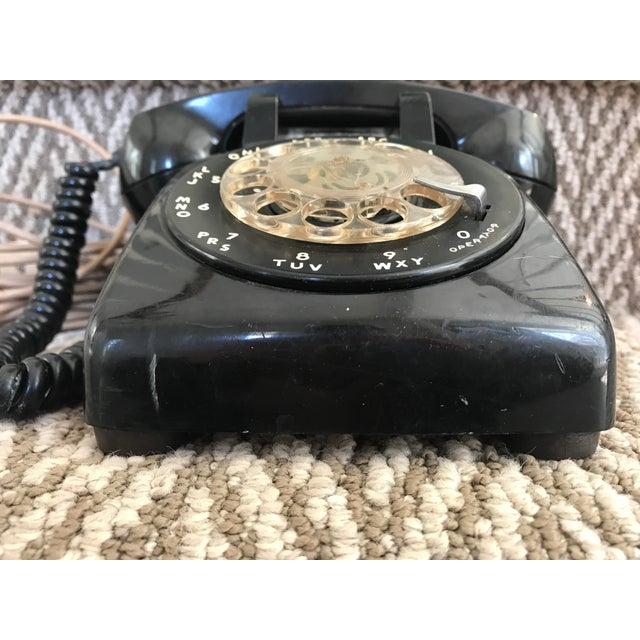 This Mid-century black phone was made by Western Electric for Bell System It has been cleaned up but not to a restorative...