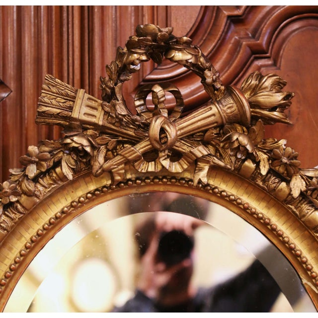 French 19th Century French Louis XVI Carved Giltwood Oval Wall Mirror With Torch Motif For Sale - Image 3 of 12