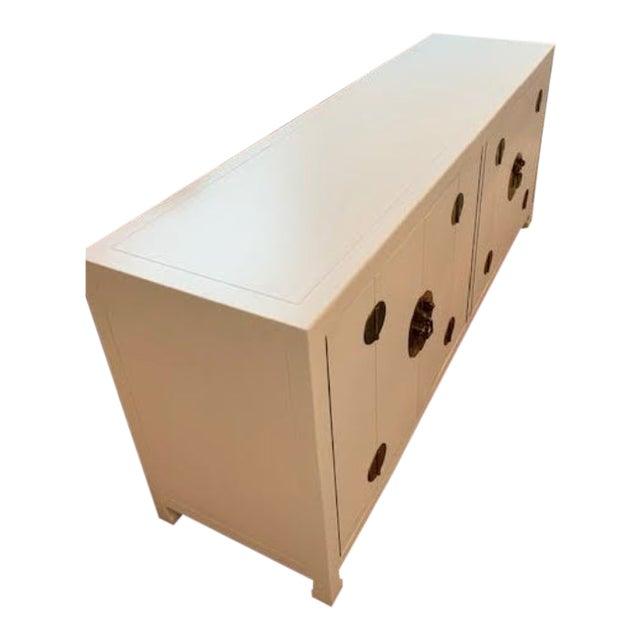 This amazing mid-century modern sideboard/console is the perfect statement piece for any space! We have repainted it white...