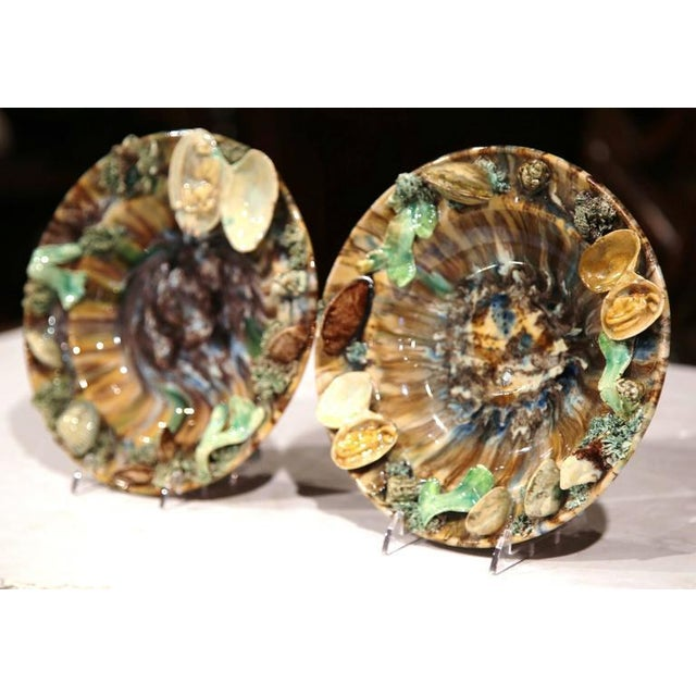 This colorful pair of Majolica wall hanging plates was sculpted in France, circa 1920. Perfect for a seaside beach home,...