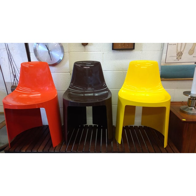 Offering this set of three bright plastic mid-century modern chairs. They are not marked but appear to be Tango Chairs by...